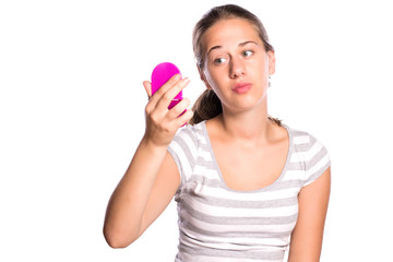 Woman looking her pink mirror insecure