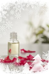 Glass phial and pink petals in a christmas frame