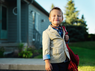 little boy portrait waiting to go to school