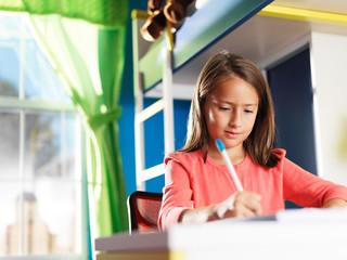 little girl doing home work for school