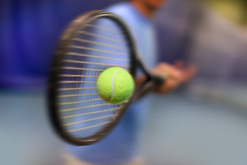 .male tennis player in action