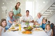 Composite image of family having meal at dining table