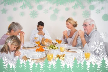 Composite image of family saying grace before eating a turkey