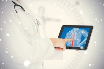 Doctor showing her tablet with red spin