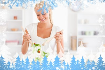Composite image of gorgeous woman mixing a salad