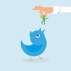 Human hand feeds blue bird