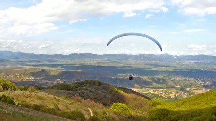 Paragliding over the mountain range