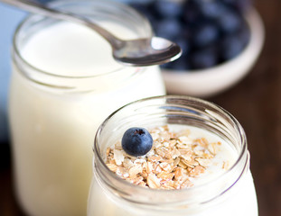 Jars of fresh natural yogurt and  blueberries