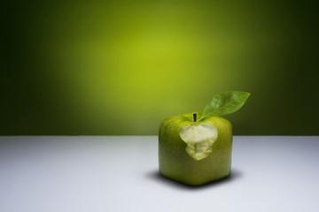 Bitten, green cube apple.