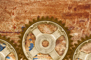 Ancient cog wheels against a rusty background