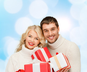 smiling man and woman with presents