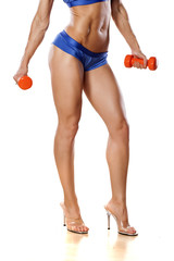 pretty muscular female legs and hands with weights