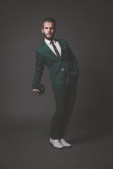 Business fashion man wearing green suit with white shirt and bla