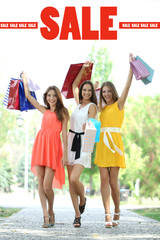 Concept of discount. Beautiful young woman with shopping bags
