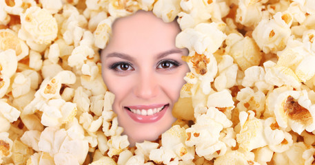 Woman beauty face with popcorn frame, close-up