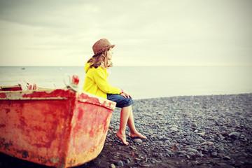 Beach, boat and girl