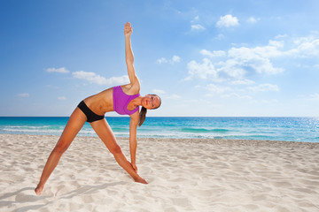 Smiling young woman stretching body with  arm up