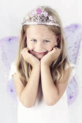 Beautiful little girl wearing diadem and butterfly wings