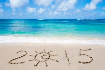 """Sign """"2015"""" on the beach"""