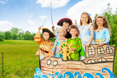 Happy kids in different costumes stand on ship - 70539548