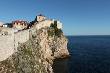 Dubrovnik,the old wall, rocks and blue sea