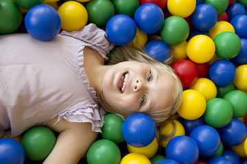 Girl playing in the balls