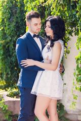 Wedding shot of bride and groom in green park