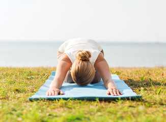 close up of woman making yoga exercises outdoors