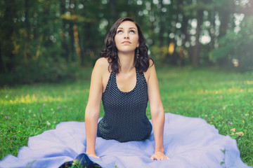 Woman Practicing Yoga Outdoors on Blanket