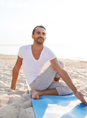 man doing yoga exercises outdoors