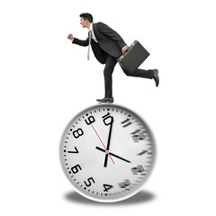 Businessman running on clock