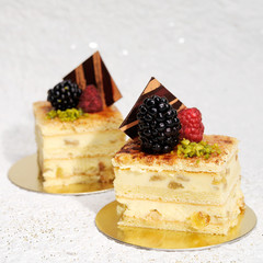 Slices of cake with berries and chocolate