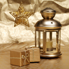 Candle, gifts and star on a gold background