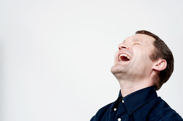 Hard laughing middle aged man