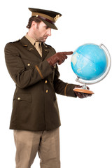 Military officer pointing the globe