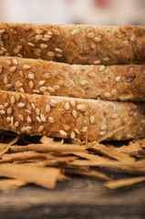 slices of whole bread on wooden table