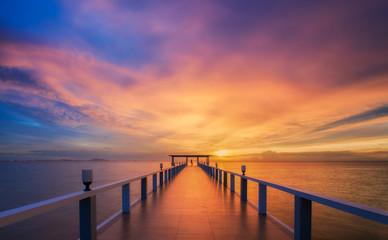 Wooded bridge in the port between sunrise.