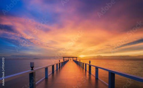 Wooded bridge in the port between sunrise. - 70545313