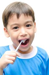Little Boy Brushing Teeth on white background
