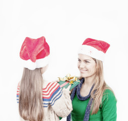 Baby girl giving Christmas gift to her happy mother, isolated on