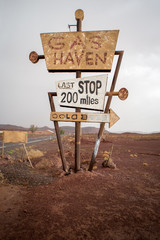 Tall vintage gas sign standing in the desert