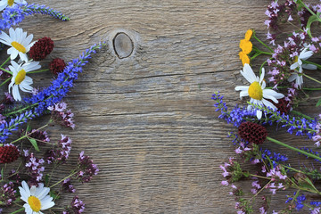 Wild flowers on an old wooden background
