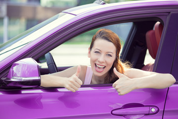 Woman driver happy smiling showing thumbs up