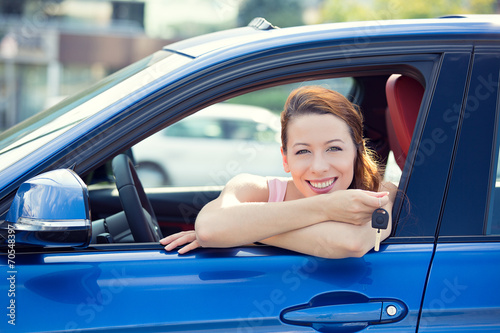 woman, buyer sitting in her new car showing keys - 70548397