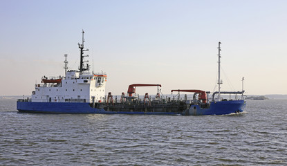 dredging vessel sails on the sea