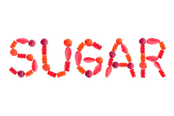 """Word """"SUGAR"""" made of red sugary candies, isolated"""