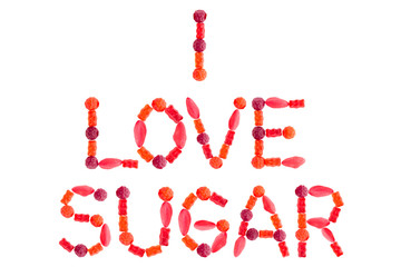 """Phrase """"I LOVE SUGAR"""" made of red sugary candies, isolated"""
