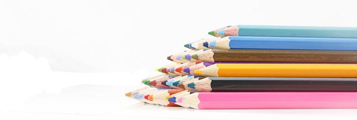 heap of color pencils against  white