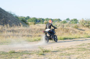 Rider on sport bike for enduro on motocross track