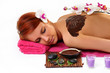 Woman enjoying a chocolate beauty treatment at the health spa